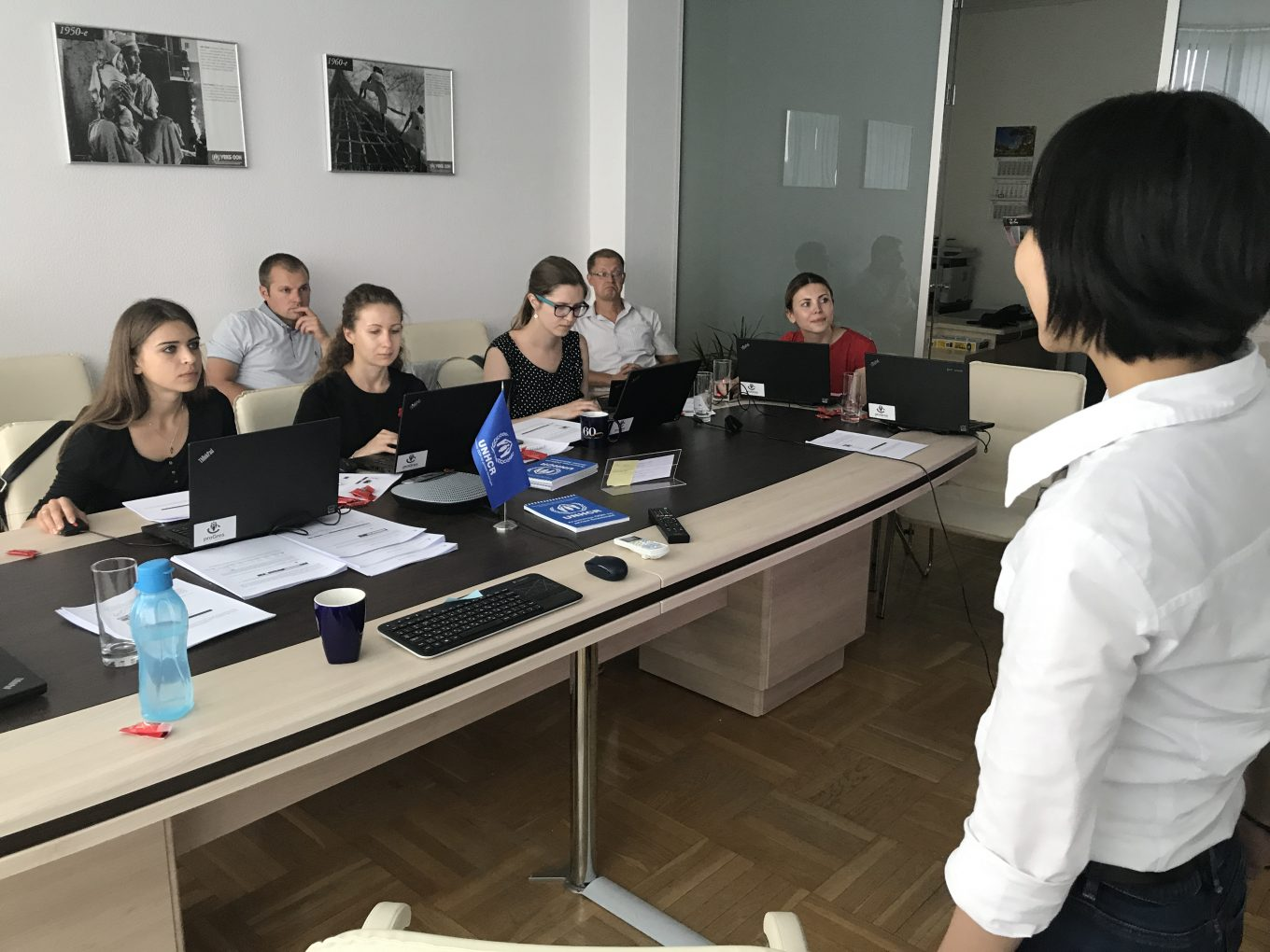 © UNHCR/ Charlotte Arnaud / Partners from the Belarusian NGO Refugee Counseling Service and UNHCR staff are experimenting in the training environment of the software under the guidance of Hau Yan Wan from the deployment team.