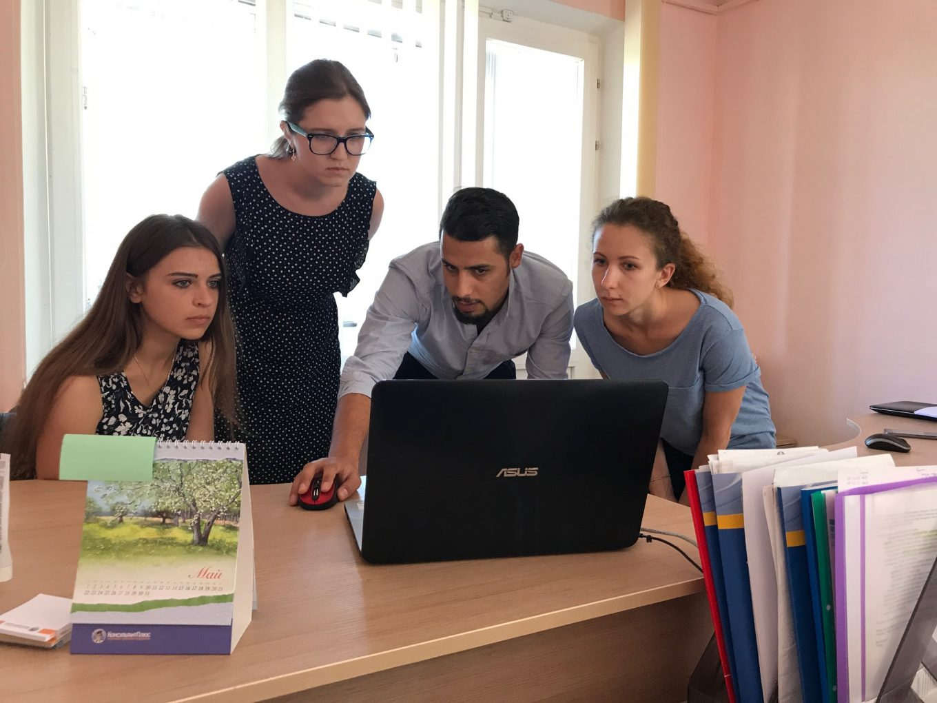 © UNHCR/ Charlotte Arnaud / A few days after the training, Mohammad Anini from the deployment team visited Volha Bakhur Julia Dvydova and Hanna Bystrova in the offices of the Refugee Counseling Service, to answer questions and support the new users.