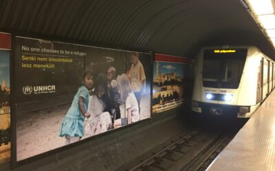 Posters Urge Passengers and Passersby to Remember Refugees