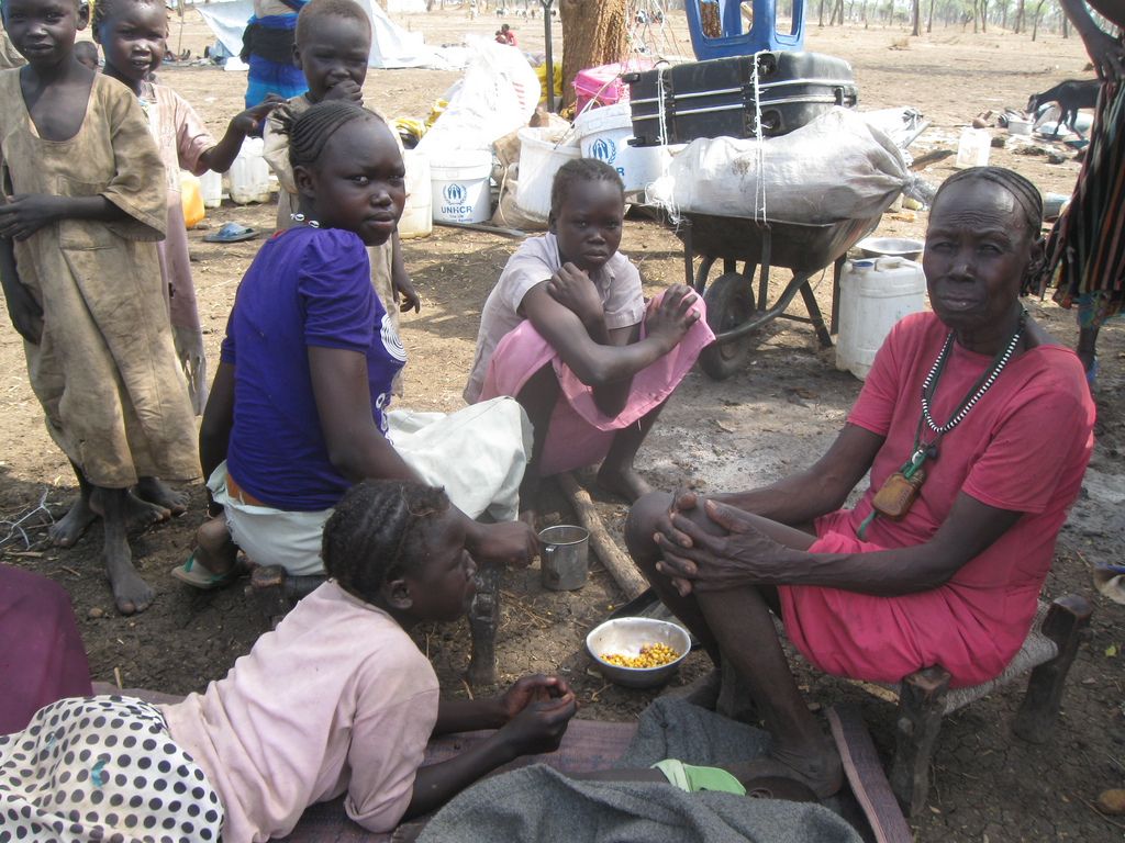This woman and her family were affected by the recent violence. Some of their belongings and aid are seen in the background. © UNHCR/P.Rulashe