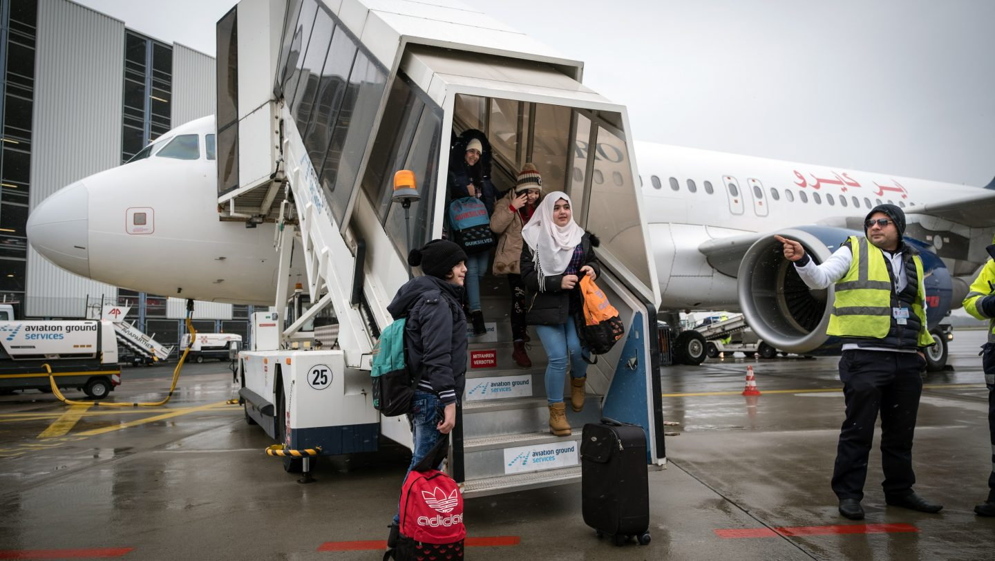 Germany. Syrian and non-Syrian resettlement refugees arrive via air charter at Hanover Airport.