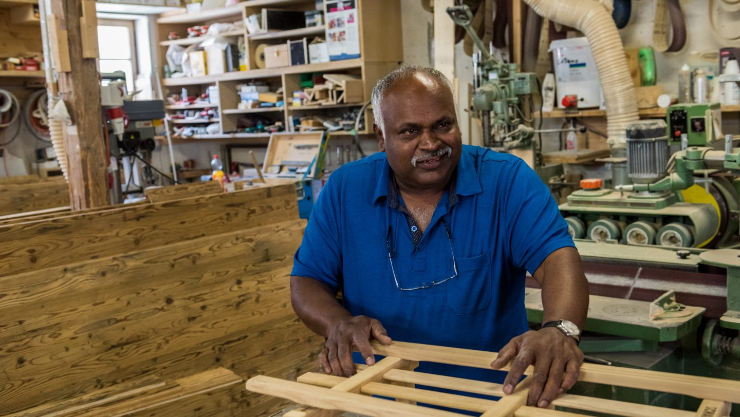 Switzerland. Successful Sri Lankan refugee sustains traditional culture in his host country.