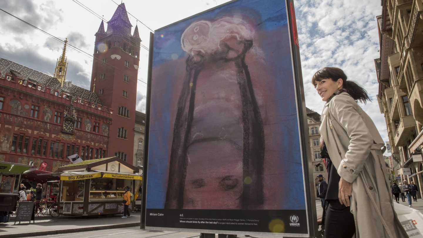 "Switzerland. Art Stands with Refugee Women in Basel, with the art and poster project ""Where should birds fly after the last sky?"""