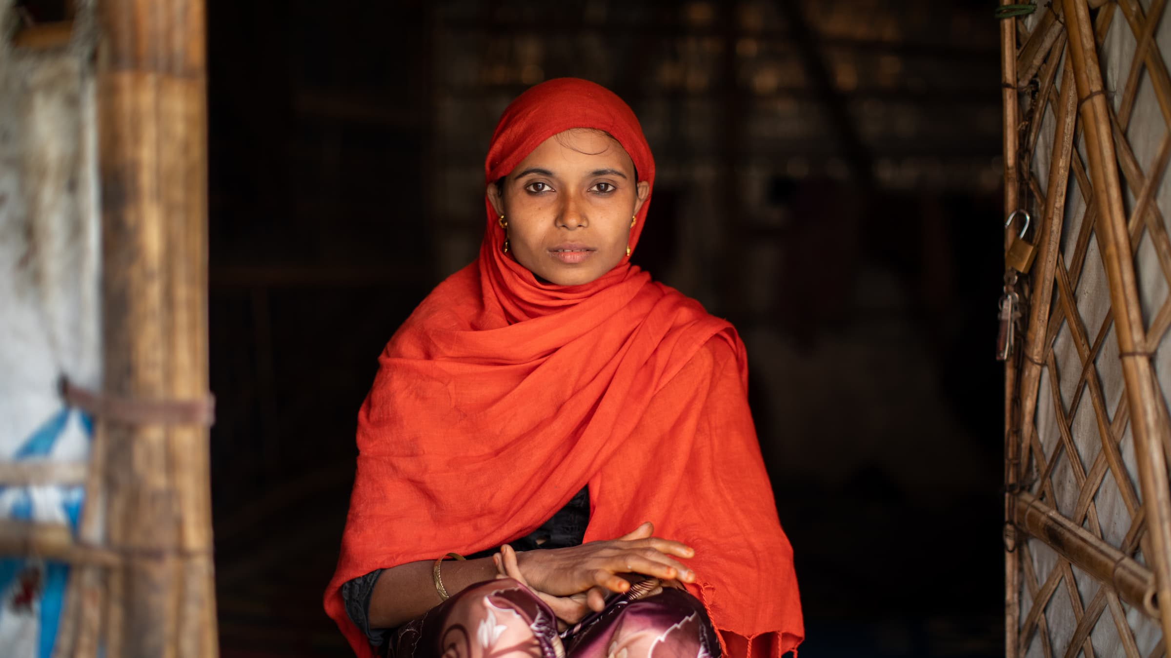 Bangladesh. Rofiqua Begum, a refugee in Kutupalong camp in Cox's Bazar, Bangladesh, sits in front of the shelter where she lives with her four children.