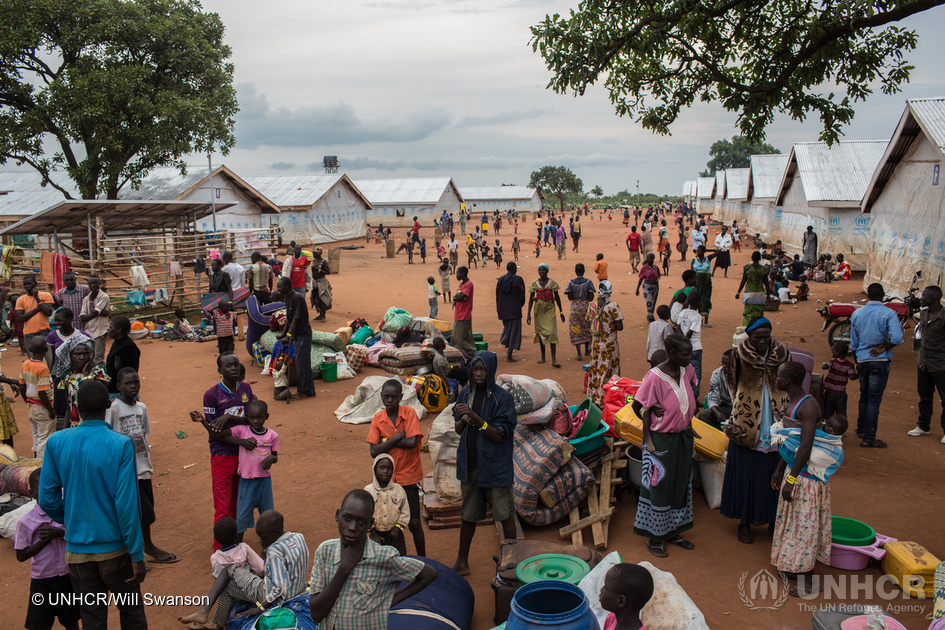 Newly arrived South Sudanese refugees receive accommodation and meals at the transit centre in Adjumani, in northern Uganda. © UNHCR /Will Swanson