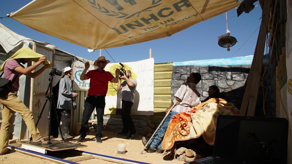 The group have constructed many materials from scratch, including hand-painted backdrops and stage lights made from discarded olive oil cans and aluminium foil. © UNHCR/Houssam Hariri.