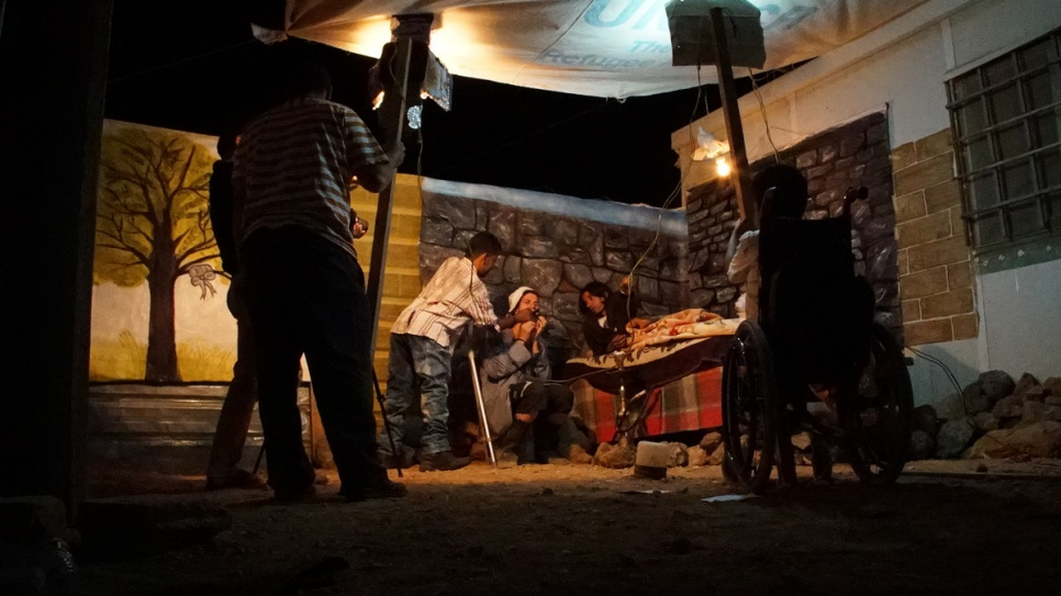 Filming often takes place at night due to the lack of electricity in the camp during the day, when the group hold rehearsals instead. © UNHCR/Houssam Hariri.