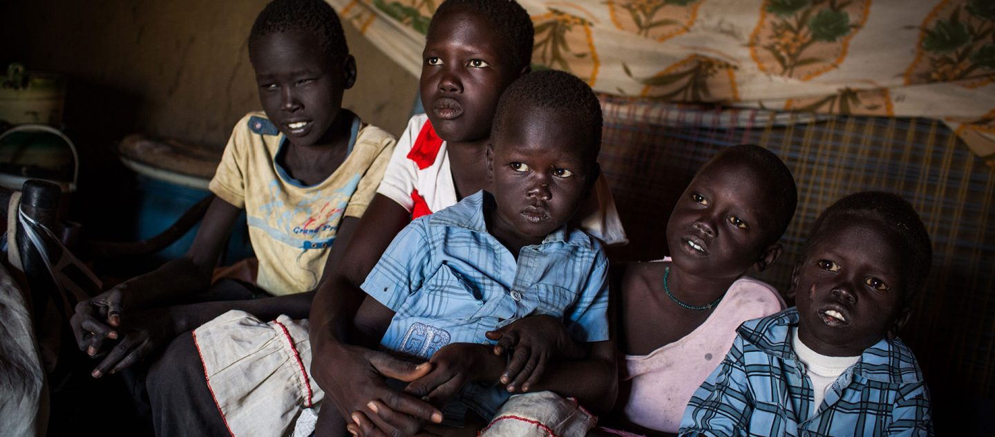Thonchol Akuol, 11, Lina Akuol Mayol, 13, Dongwei Akuol Mayol, 3, Sunday Akuol Mayol, 8, Juach Akuol Mayol, 6 pictured in their temporary accommodation in Pariang, South Sudan, on November 22, 2014. © UNHCR/Andrew McConnell