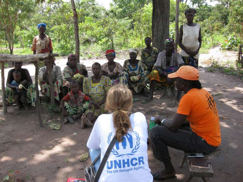 A UNHCR officer listens as displaced villagers tell of their dreadful living conditions in an isolated area near Kabo, north of Bangui, capital of the Central African Republic.