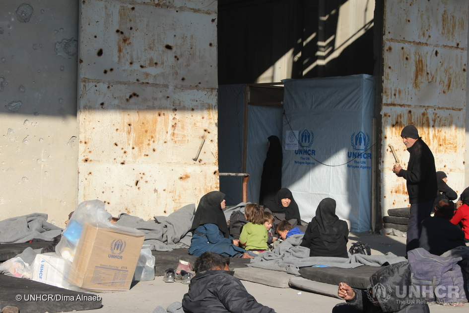 Displaced residents from east Aleppo rest at a centre where UNHCR and other agencies provide shelter and aid including clothing and thermal blankets in west Aleppo, Syria. © UNHCR/Dima Alnaeb