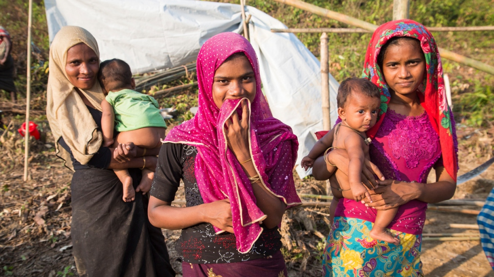 Dil Bahar, 25, Yasmin, 15, and Humaira, 21, fled their homes after their village was burnt. They were relocated by UNHCR to Kutupalong Extension. © UNHCR/Roger Arnold