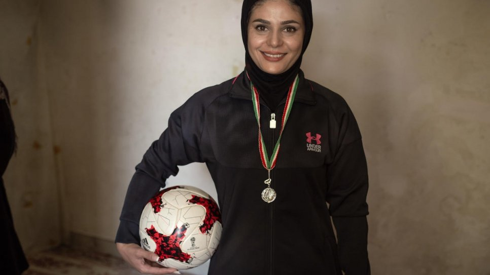 Afghan sports coach helps young refugees find a path to school in Iran