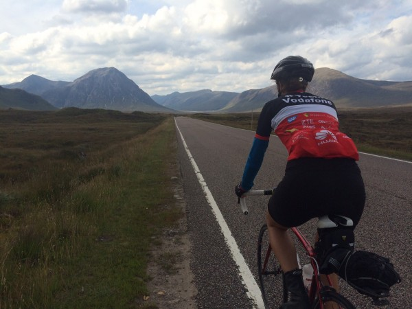 Photo of Jackie Strecker, Learn Lab Manager, biking through Scotland.