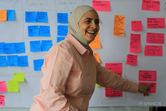 Rana Dajani, director of We Love Reading, brainstorms ideas during the Amplify Refugee Education Challenge design bootcamp
