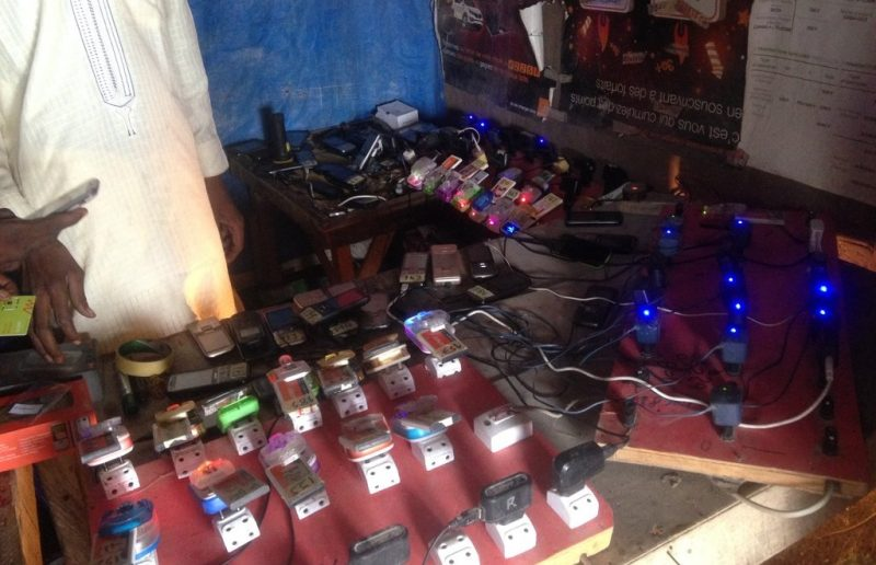 A mobile charging station located in a local market in Kabelawa Camp.