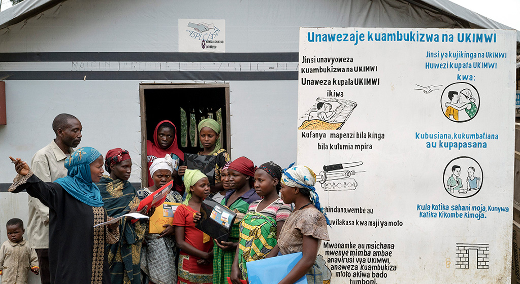 Congolese women at a camp for the internally displaced discuss the dangers of HIV/AIDS in 2014. Agencies such as UNHCR were active in projects to try to reduce the spread of sexually transmitted disease among an estimated 2.6 million IDPs in the Democratic Republic of Congo.