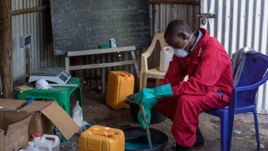 Innocent prepares liquid soap at his homestead in Kakuma Refugee Camp, where he has set up a laboratory for soap production. ©UNHCR/Samuel Otieno