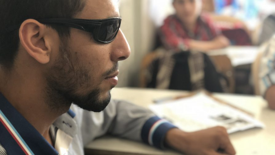 With resolve and a cell phone, blind refugee resumes school