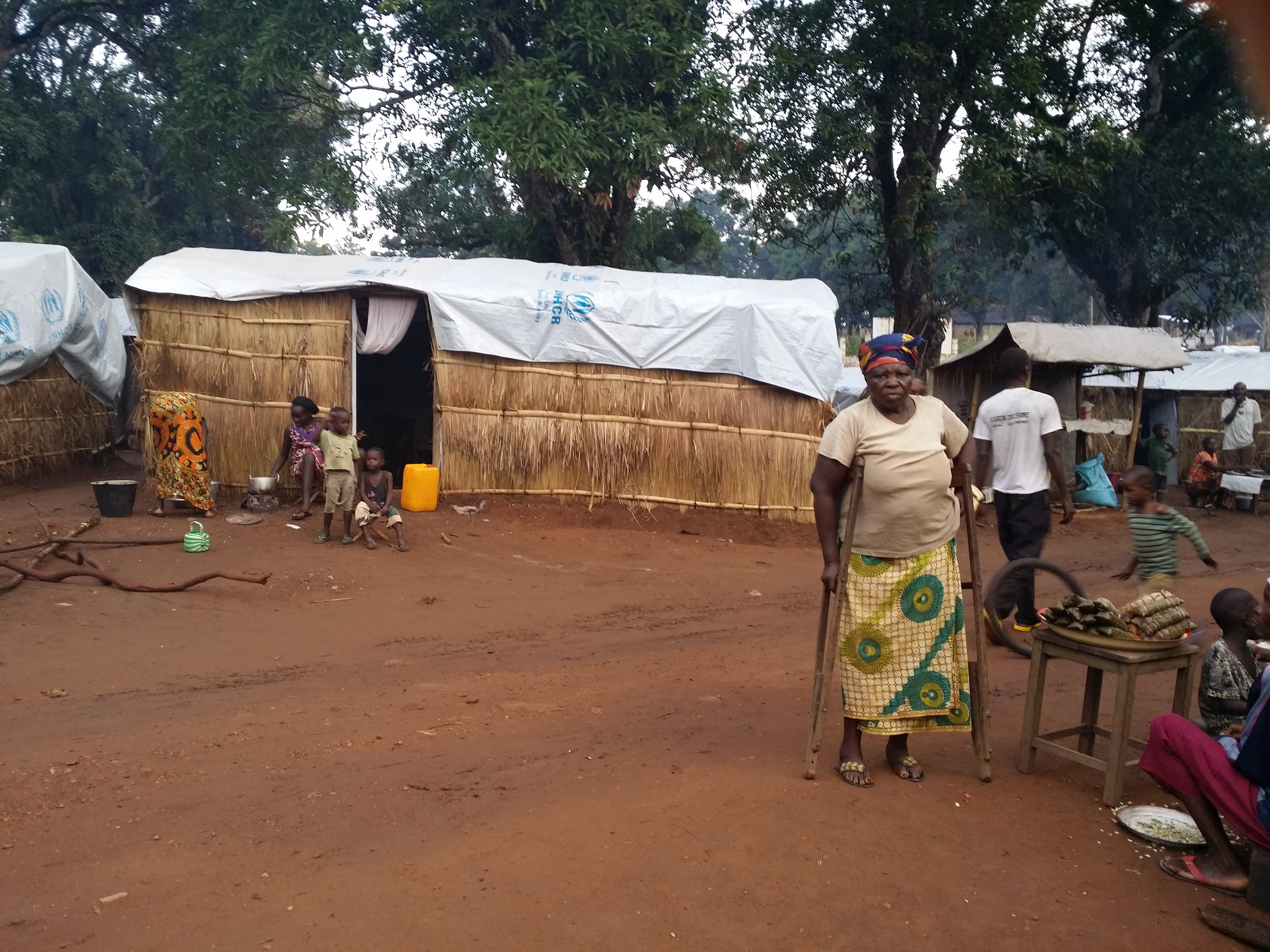 Disabled woman in front of self-constructed shelter with UNHCR provided material in IDP camp in Bambari, Central African Republic. /UNHCR/Lisa van Hogerlinden
