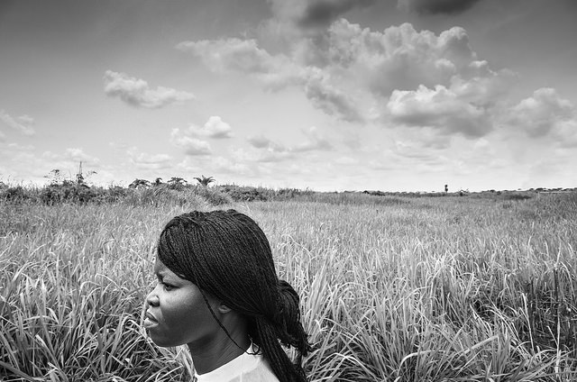 Refugee woman in field, black and white