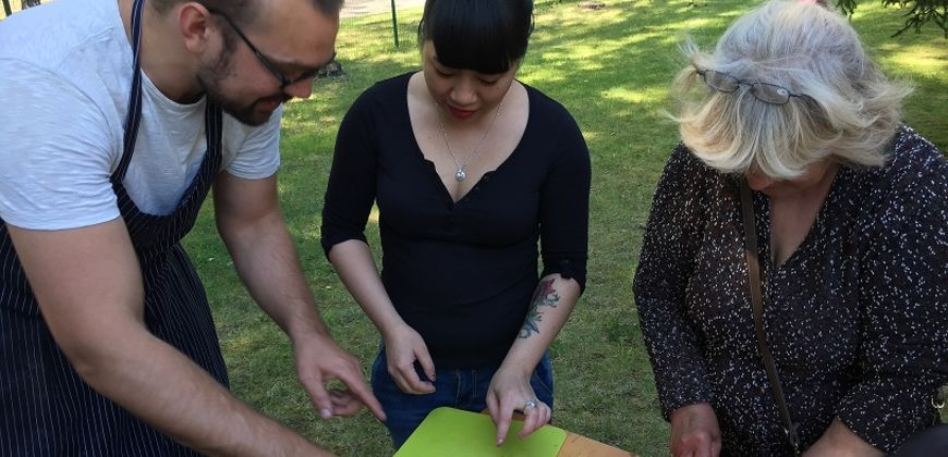 Refugees and famous chef cook together during World Refugee Day celebrations in Latvia