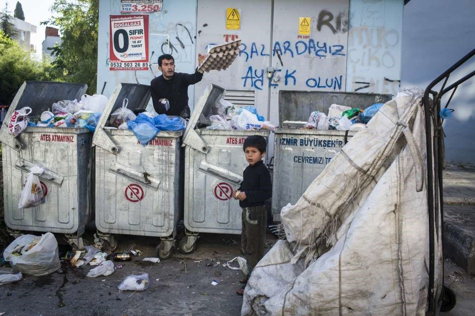 Uday sometimes misses out on school, which he attends, to help his father gather recyclables. © UNHCR/Andrew McConnell
