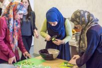 Volunteers give refugees a taste of life in Lithuania