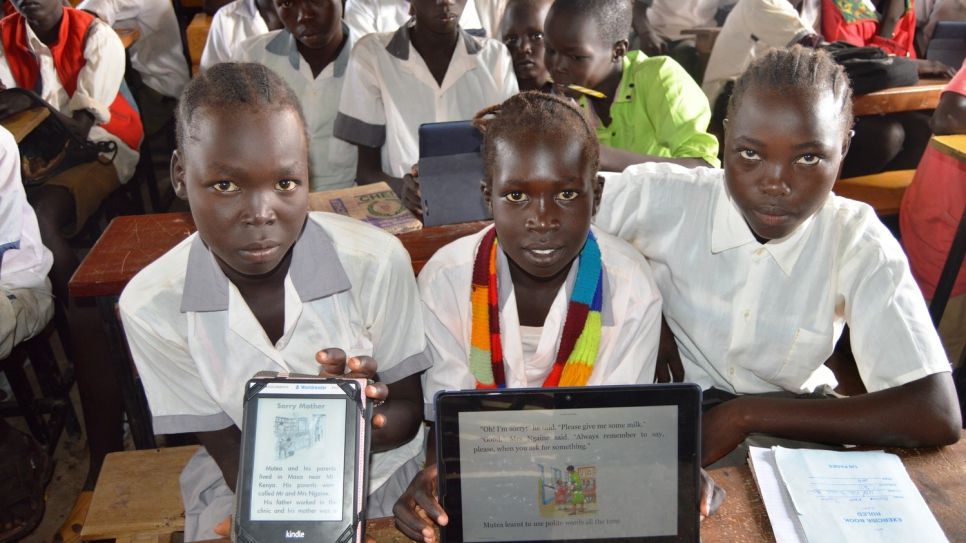 Students with the tablets they are learning to use. © UNHCR/Catherine Wachiaya