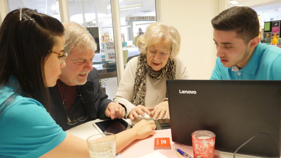 Young refugees teach IT skills to seniors in Sweden