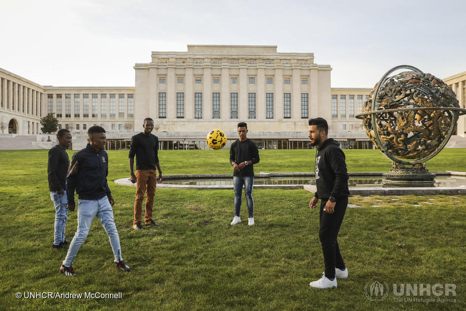 Switzerland. Refugees have a kick-about at the Palais des Nations in Geneva
