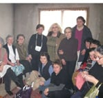 Biserka Vukasinovic (centre) hosts a sewing class in her newly built home