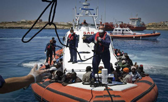 An Italian coastguard vessel docks at Lampedusa after rescuing 142 people who had fled from Tripoli