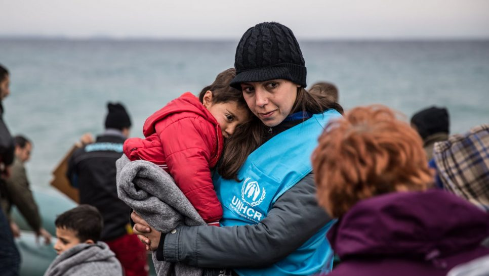 A UNHCR staff member comforts a young refugee boy after his boat landed on the Greek island of Lesvos. ; Over one million refugees and migrants arrived in Europe by sea in 2015. An overwhelming majority were fleeing war and persecution. More than 80 percent of those who survived the crossing came from the world's top refugee-producing countries.