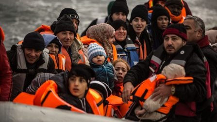 A boatload of refugees prepare to disembark from their boat that has crossed the short ribbon of sea between Turkey and Greece. ; Over one million refugees and migrants arrived in Europe by sea in 2015. An overwhelming majority were fleeing war and persecution. More than 80 percent of those who survived the crossing came from the world's top refugee-producing countries.