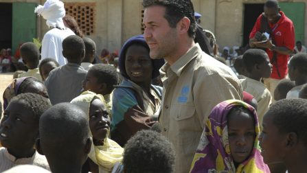 Chad / Khaled Hosseini, author of the best-selling novel The Kite Runner is welcomed by a group of children in Kounoungou refugee camp, eastern Chad. Hosseini was last year named a Goodwill Envoy for the UN refugee agency in the USA. / UNHCR / T. Irwin / February 2007