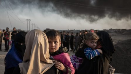 Iraqi IDP's displaced by fighting in the village of Shora, 25km South of Mosul, reach an Iraqi army checkpoint on the Northern outskirts of Qayyarah. Qayyarah was liberated from ISIS over two months ago but is still engulfed in thick black smoke from oil wells set ablaze by the retreating militants. IDP's who reach Qayyarah are taken to Ja'dah IDP camp there. ; Around 3.3 million Iraqis, ten per cent of the population of Iraq, have fled their homes since fighting in several parts of the country intensified in March 2014. With a military operation to retake the city of Mosul beginning in October 2016, new camps have been quickly built by UN agencies in Iraq to accommodate some of the anticipated 1 million people likely to be displaced. Debaga camp, completed in late 2015 for an initial 3,000 people, quickly saw its population increase tenfold. The numbers are likely to continue rising.
