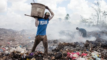 A man collects rubbish at San Pedro de Macoris municipal dump. ; Tens of thousands of Dominicans of Haitian descent were deprived of their Dominican nationality following a 2013 ruling by the Constitutional Court of the Dominican Republic. UNHCR has appealed to the Dominican government to ensure that these people are not deported and is committed to working with the Dominican authorities to find a solution for them that guarantees protection of their human rights.