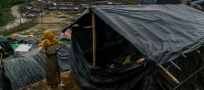 Soaked and hungry Rohingya refugees seek shelter in Bangladesh