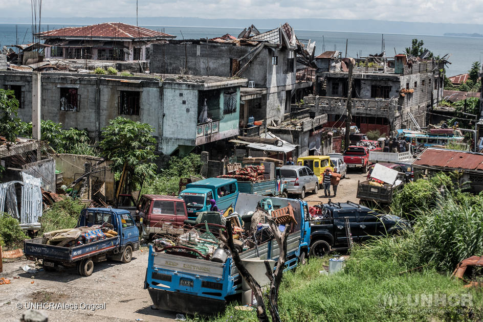 Philippines. Displaced families visit homes in war-torn city