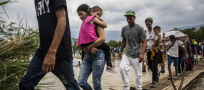 Swollen rivers, mass crowding, add to risks at Venezuela borders