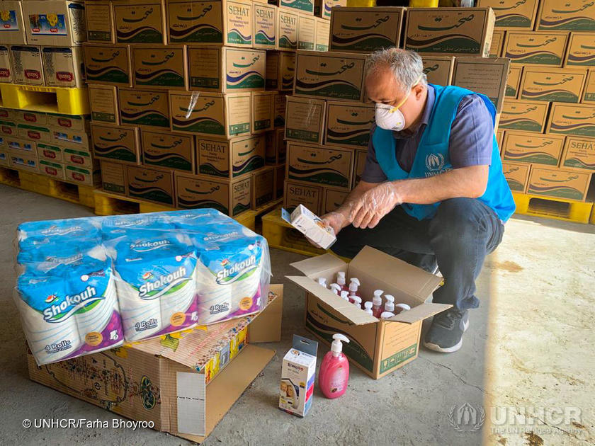 Iran. UNHCR staff packs aid-items to distribute to refugee settlements in Iran, as part of the COVID-19 response.