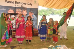 A group of Afghan refugee students performing their national song on the WRD event at the Shalimar Cricket Ground in Islamabad. © UNHCR/A. Shahzad