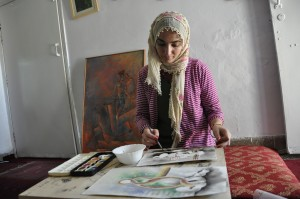 Afghan refugee defies oppression with paint