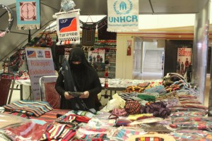 A refugee artisan displayed the products at the exhibition. H.Karim