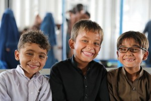 Three brothers – in light mood - posing for a photograph at the Voluntary repatriation Centre. © UNHCR/Q.K.Afridi
