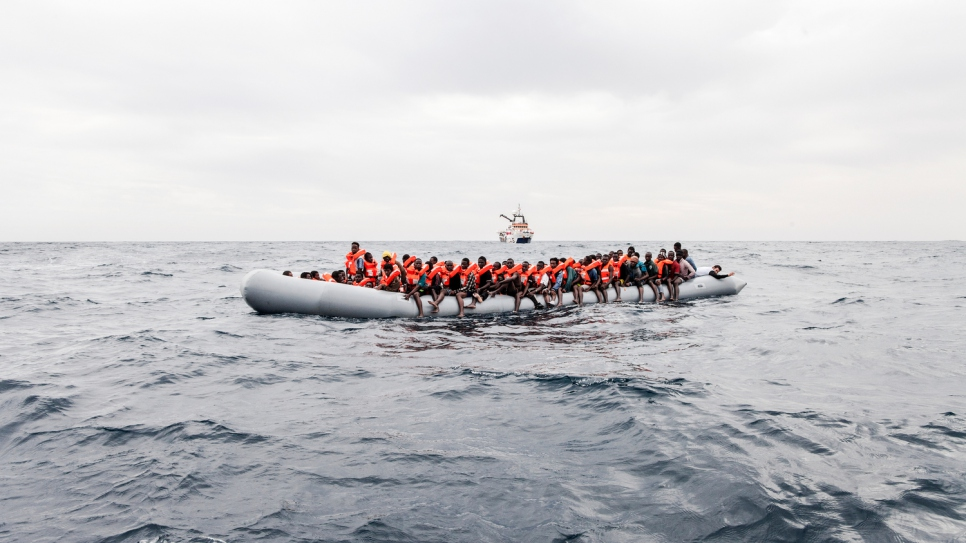 Asylum-seekers and migrants aboard a dinghy spotted by the MOAS crew in international waters off the coast of Libya. © UNHCR/Giuseppe Carotenuto