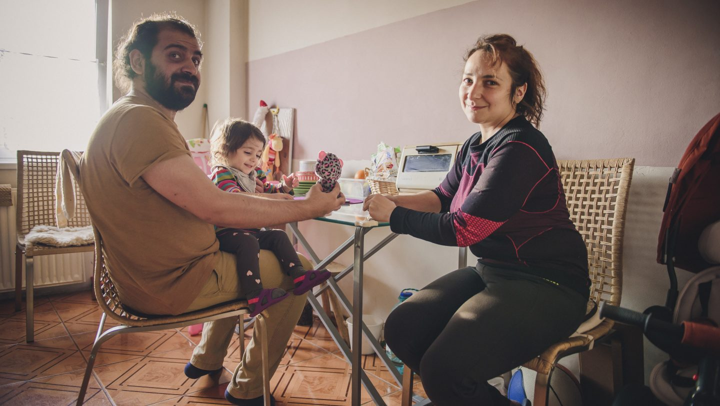 Romania. Mohammad Zatari, Syrian refugee, with his family, in hi