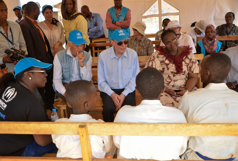 Representative of UNHCR Mr. Azam Saber, Dr. Jacques Rogge and Minister Seraphine Mukantabana in a short conversation with the martial arts team (Karate/ Wadō-ryū) in Mahama refugee camp [Photo/ IOC Shaban Masengesho]