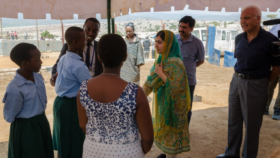 Malala talks to Burundian refugee girls, with Ngoga Aristarque [Mahama camp manager] and Saber Azam [UNHCR Representative in Rwanda] [Photo/ UNHCR - Shaban Masengesho]