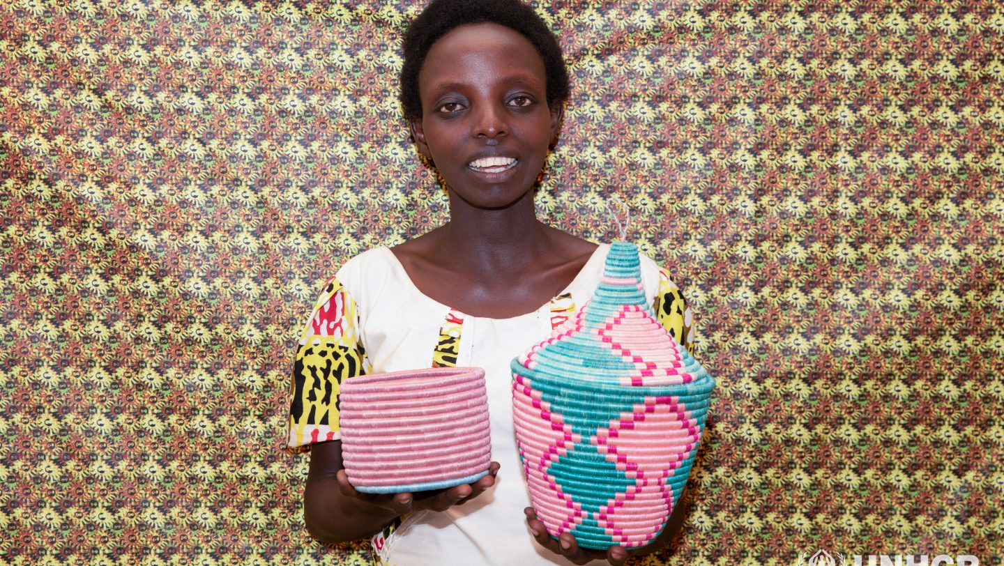 Rwanda. Francoise is a member of a group of Burundian refugee women from Mahama Camp in Rwanda who come together to produce crafts, baskets, bags, dresses, bedspreads and dishes.